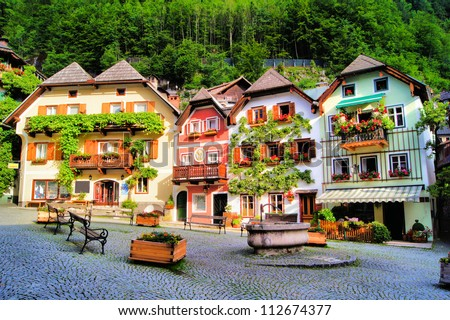 Colorful and picturesque village square in Hallstatt, Austria - stock photo