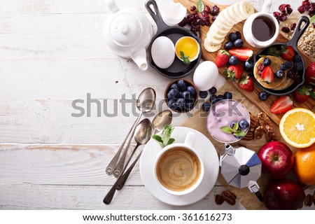 Colorful and tasty breakfast ingredients on white table #361616273