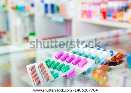 Colorful antibiotic capsule pills in blister pack. Antibiotic drug resistance. Blurry background medicine cabinet. antimicrobials capsule. pharmaceutical products