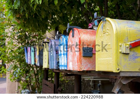 Colorful antique mailboxes on Canyon Road in Santa Fe, NM - Shutterstock ID 224220988