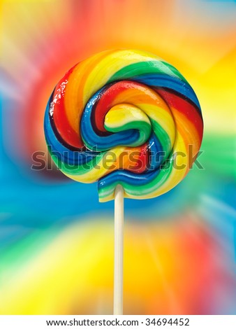 Colorful appetizing lollipop on colorful background isolated with clipping path