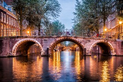 Colorful arches with lights at night in Amsterdam, Netherlands