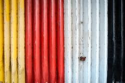Colorful architecture roller shutter ,Vintage Steel door texture background. Metal door