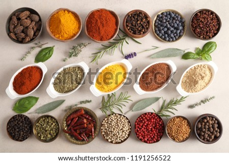 Colorful, aromatic spices and fresh herbs in a bowls. Top view. #1191256522