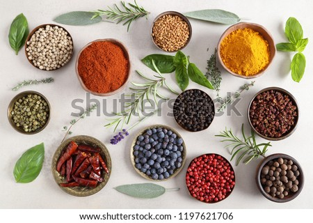 Colorful, aromatic spices and fresh herbs on a light background. Top view. #1197621706