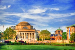 Colorful artistic HDR image of students and faculty members walking near the famous library at the Columbia University, New York City on a summer day