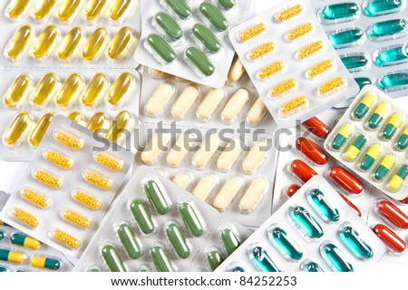 colorful assorted pills and capsules