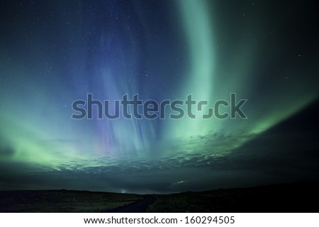 Colorful Aurora display in western Iceland - Shutterstock ID 160294505