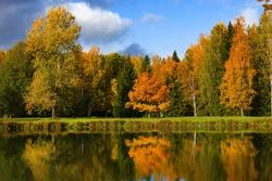 Colorful autumn foliage andriver in Pavlovsky park, Pavlovsk, Saint Petersburg, Russia