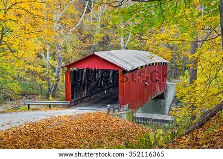 Colorful autumn foliage surrounds Putnam County, Indiana's Rolling Stone Covered Bridge.