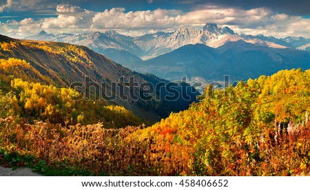 Colorful autumn landscape in the Caucasus mountains. Sunny morning scene with mountain Ushba on the background. Mkheer, Svaneti, Georgia, Europe. Artistic style post processed photo.