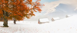 Colorful autumn landscape in the mountains. First snow in November