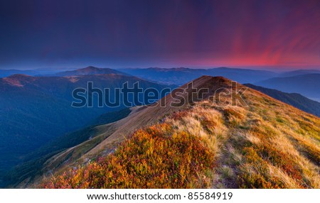 Colorful autumn landscape in the mountains. Sunset
