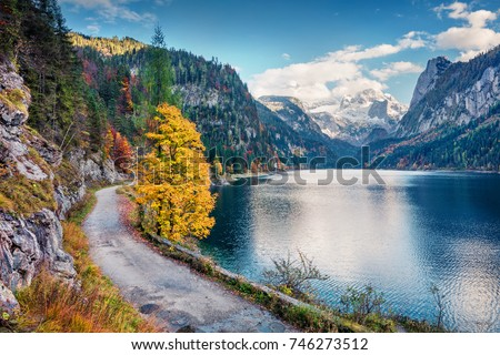 Colorful autumn scene of Vorderer ( Gosausee ) lake with Dachstein glacieron background. Picturesque morning view of Austrian Alps, Upper Austria, Europe. Traveling concept background. - Shutterstock ID 746273512