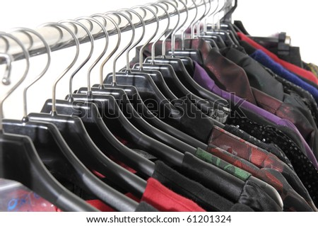 colorful autumn/winter clothes on hanger in a row