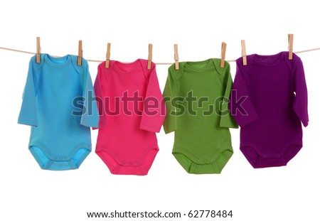 Colorful baby goods hanging on the clothesline - stock photo