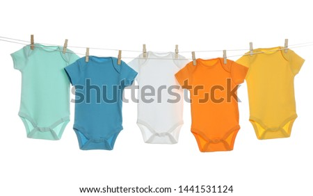 386a07c24 Kids clothes on clothes line Images and Stock Photos - Page: 2 ...
