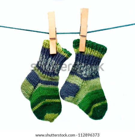 Colorful baby socks hanging on a cord