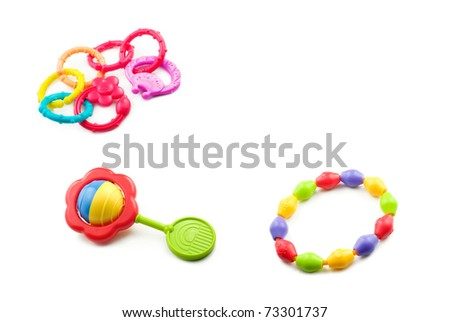 Colorful baby toys on a white background with copy space