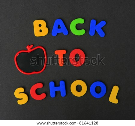 Colorful Back To School letters with Chalkboard Apple on Black Board