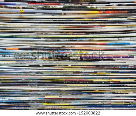 Colorful background made of stacked magazines