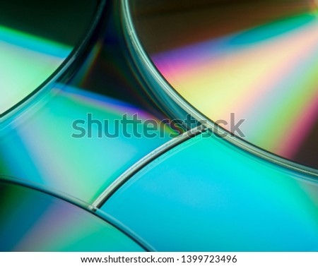Colorful background with shiny compact discs.