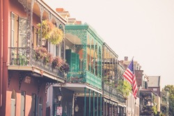 Colorful balconies line the streets in the French Quarter of New Orleans Louisiana
