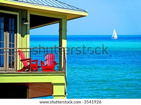 Colorful Balcony Over Emerald Seas