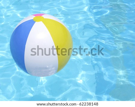 Colorful ball floating in a blue swimming pool