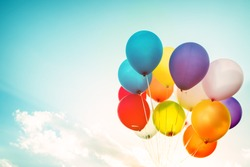 Colorful balloons done with a retro effect. Concept of happy birth day in summer and wedding, honeymoon party use for background. Vintage color tone style