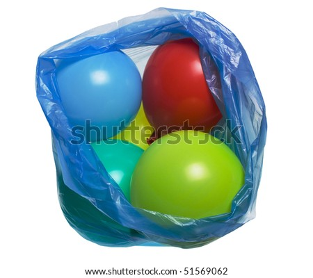 Colorful balloons in plastic bag isolated on white - stock photo