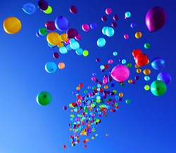 colorful balloons on a blue sky background