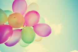 Colorful Balloons on Retro Vintage Sky