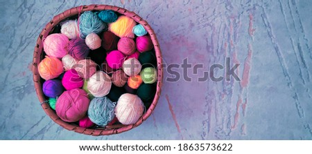 Colorful balls of wool thread in the basket on the floor Stok fotoğraf ©
