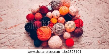 Colorful balls of wool thread on the floor Stok fotoğraf ©