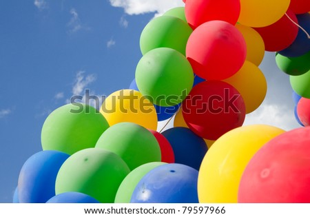 Colorful  balls on a background  blue sky