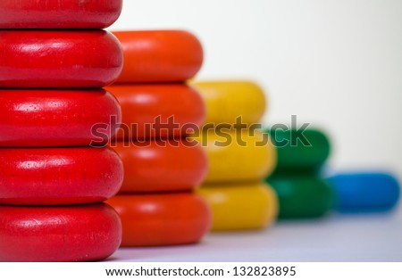 Colorful bar chart made from stacked wooden toys representing business report