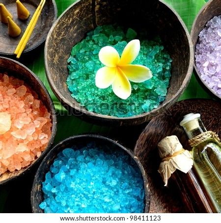 Colorful bath salt with massage oil bottles