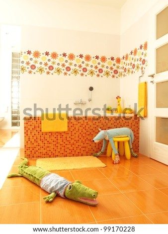 Colorful bathroom with soft toys.