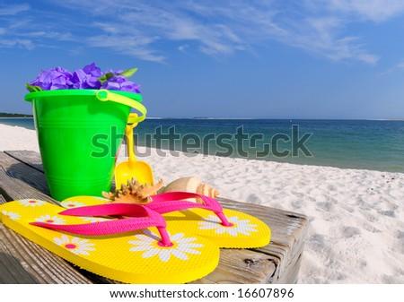 Colorful beach accessories on boardwalk by ocean