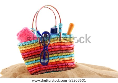 colorful beach bag with toys and sunglasses for the whole family