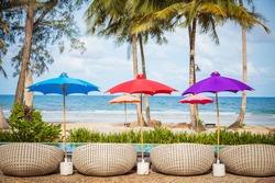 Colorful beach beach umbrella with blue sea and sky