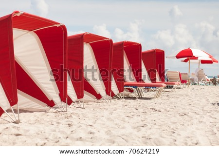 Colorful beach cabanas along the popular South Beach in Miami.