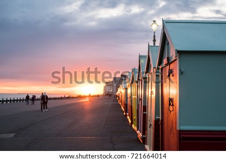Colorful Beach Huts during sunset at Brighton and Hove, England