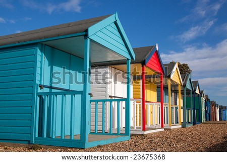 Colorful beach huts on a shingle beach