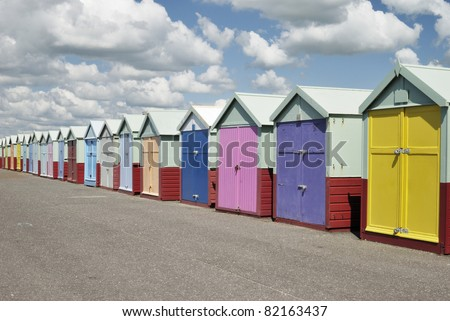 Colorful beach huts on seafront promenade at Hove. Brighton. East Sussex. England