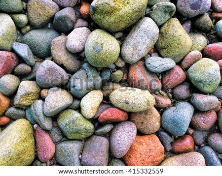 Colorful beach stone background, red stones, green stones, pink stones, rocks on the beach photo background, volcanic beach stones, colorful pebbles background, pebbles of the beach photo wallpaper