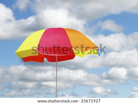 colorful beach umbrella with sky background