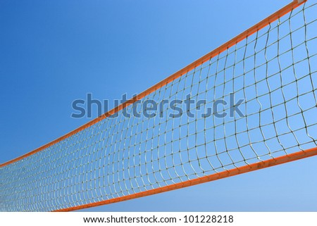Colorful beach volley net with blue sky.