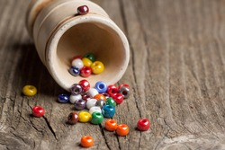 colorful beautiful glass beads with ceramic glass on old wooden table